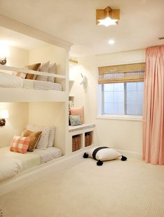 The sweetest girls room with built in bunk beds, a starry brass light fixture