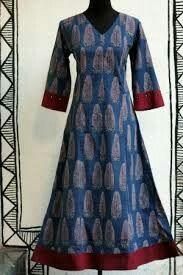a long elegant indigo red ajrakh printed anarkali, with hand embroidery & traditional mirror work on sleeves. pair it with silk or chanderi dupatta for a Salwar Designs, Kurti Neck Designs, Kurta Designs Women, Blouse Designs, Long Kurti Patterns, Salwar Pattern, Dress Patterns, Stylish Dresses For Girls, Stylish Dress Designs