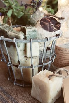 homemade soap in metal basket - i do unwrap any soap bars I have whether store bought or homemade & put them all in a metal basket - a nice aroma for the bathroom!
