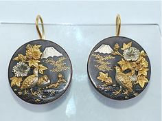 Shakudo Earrings    Japanese Shakudo earrings circa 1890, discs decorated with exotic flora and fauna. Shakudo, an alloy of gold and copper, was traditionally used in Japan to decorate Samurai sword fittings.