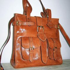 Everyone should have a brown buckle bag.... great with jeans / boots.