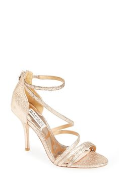 Stopping traffic with these sparkly gold sandals.