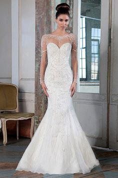 This illusion Sabrina neckline fit and flare gown features long sleeves, intricate hand beading and an illusion back. Justin Alexander Signature Spring 2016