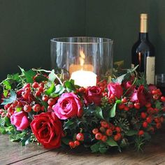 Hurricane Vase centrepieces - no pink with deep red grand prix roses, berries, white flowers, wild natural look. and some pearls