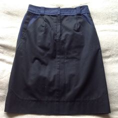 Louis Vuitton Black Navy Cotton Structured Skirt Excellent condition authentic LV skirt in black with navy blue accent trim at top and pockets; pockets in front and back, Louis Vuitton engraved on buttons. Straight pencil skirt with structured fit, like a stiff-ish cotton. Fits like a size 4 although I think FR36 converts technically to a 6; measurements coming soon! Louis Vuitton Skirts Pencil