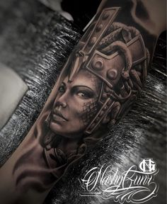 Medusa wearing a helmet, with scales on her face. This mens leg piece is the work of Nashy Gunz, an artist based in Gold Coast, Australia.