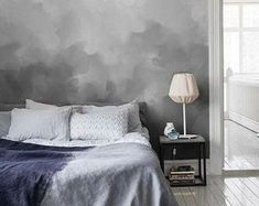 Ombre wall paint inspiration, on trend for 2016. The transition of grey and paint brush technique reminds me of dark clouds and offer a moody ambiance.