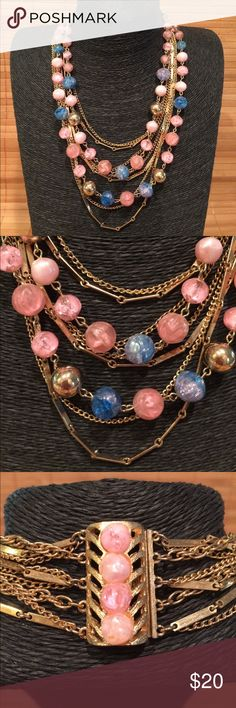 "Cyndi Lauper Necklace Channel the Eighties with this unique, multi strand necklace! Awesome to wear with your hair in an up-do since it has a gorgeous clasp in back. This is a vintage costume piece with no markings from my vintage queen sister's collection. Beads seem to be a higher quality plastic. Metal is ""gold"" tone - costume piece. Measures about 19"" on the shortest strand and about 25"" on the longest strand. vintage Jewelry Necklaces"