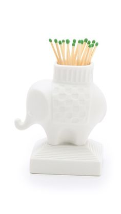 Love those green matches! Elephant Match Holder | Jonathan Adler.