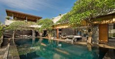 Villa Mana in Bali / Pool surrounded by trees. Bougainvillea bonsai or old olive trees / Villa & Pool inspiration byCOCOON.com