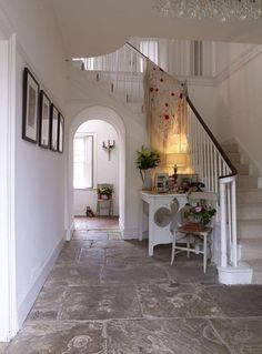 Love the table next to the stairs.