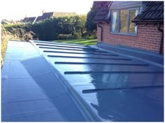 Lead grey profile Sarnafil Roof in Gaydon. Tapered to falls insulated base.