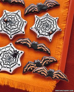 Just as setting out milk and cookies will appease a jolly elf, these gingerbread critters are sure to tame ornery beasts. Lemony royal icing cloaks the cookies with spider web and bat disguises. Use extra icing to give the bats staring eyes and to make chubby spiders.