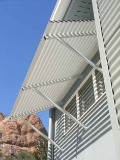 COLORBOND® STEEL window awning with louvre D slats in Surfmist®
