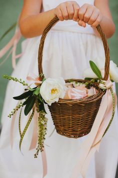Pretty basket filled with petals and adorned with flowers and ribbon by Chesnut & Vine ~ we ❤ this! moncheribridals.com