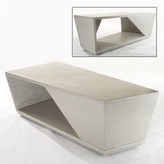 ASKEW TABLE This bold, asymmetrical table features unusual angles coming together to create a faceted look. One-inch thick walls intersect two horizontal, usable surfaces of highly polished colored concrete. Despite the table's size, its open design gives it an airy feel.