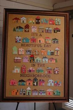 School auction project: It's a beautiful day in the neighborhood - each child makes a house.