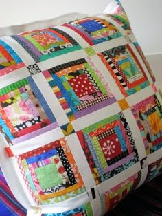 Scrappy Log Cabin Pillow, I love this design...have my whole life. This is such a easy design, I made a california king comforter when I was 18yrs old on a brother machine...it was blue, white and mauve...was beautiful!! U can throw any color together and it makes a  masterpiece :)