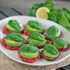 A paleo take on a Caprese salad with tomatoes and basil fresh from the garden. Heirloom tomato avocado Caprese salad is the perfect summer appetizer. | cookeatpaleo.com