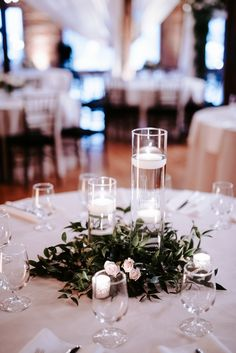 Greenery and candle centerpiece, Italian ruscus centerpiece, floating candles and greenery, simple tablecenterpieces, affordable centerpieces, florals: Wildflowers LLC, photography: Eden Ingle, venue: One Cannery