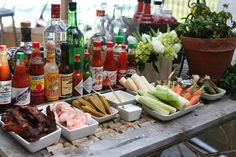 Bloody mary bar details: Titos Vodka, Graduate Rye Vodka, Black Bottle Scotch Whisky, Ledaig Single Malt Scotch and Vida Mezcal, 5 different kinds of bloody mary mixes, 12 different hot sauces, lemon, lime, jalepenos, salt, pepper, peppered bacon, shrimp, pickled okra, hearts of palm, pickled pearl onions, celery, carrots, olives, horseradish, pickles.