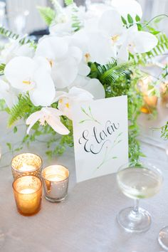 Orchid Centerpieces || See the wedding on Style Me Pretty: http://www.StyleMePretty.com/2014/02/13/block-island-wedding-at-the-spring-house-hotel/ Photography: leila brewster