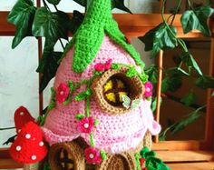 This is a one of a kind newly handmade crochet Fairy or Gnome House . Made with cotton and acrylic yarns , this house is designed to last for many years. This is not considered to be a toy , but is for decoration purposes. This house is 15 inches tall My houses are decorated with crochet flowers and beads , mushrooms and windows. I do not sell patterns for the houses. I ship in the U.S only. I only accept pay pal at this time.
