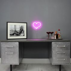 WITH EVERY HEART BEAT, THE MINI END IS HERE TO WIN YOU OVER! THE PERFECT FINISHING TOUCH TO ANY ROOM Glowing hot pink, The End's lil bro...