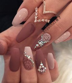 Combination of matte and shiny colors on nails is very popular, and rhinestones make it glamorous. This Earth colors – nude and darker red, are my favorite.