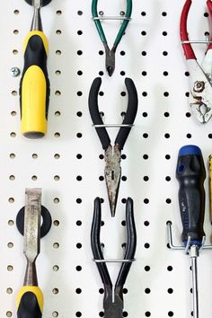 Organize Tools on a Peg Board (this one is one a Pocket Door so it slides away!)