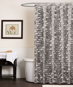 Shower in style and create a calm and classy atmosphere with this elegant curtain. With laser-cut circles exquisitely hand-stitched for a 3-D effect, this sophisticated accent can easily be installed for an instant bathroom makeover. 72'' W x 72'' H100% polyesterDry cleanImported<...