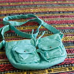 Mossimo purse Turquoise over the shoulder purse. 2 front pockets with zip. One inner pocket zippered. Soft leather like material Mossimo Supply Co Crossbody bags. Bags Crossbody Bags