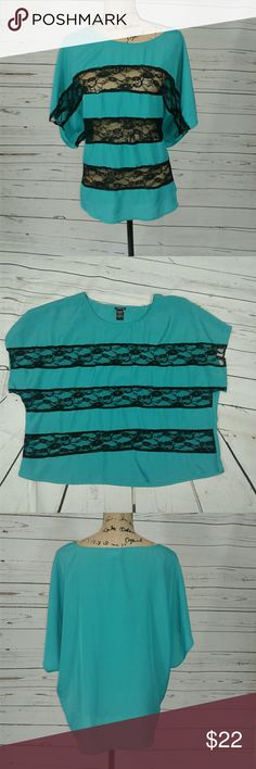 Torrid 2 silk and lace dressy top Gorgeous teal top (my pics make it look blue, but it does have green in there) with lave on front. 100% polyester. Armpit to armpit is 26 inches. Shoulder to hem is 26 inches. torrid Tops Blouses
