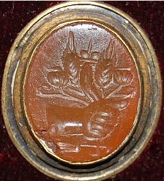 Yellow sard gem engraved with the left hand of Fortuna (?) holding a cornucopia, ears of corn and poppy-seed vessels; below is a steering-oar. Roman Imperial.  Date 1stC-3rdC