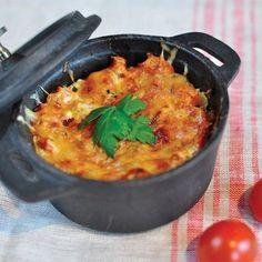 Recette de gratin de ravioles aux courgettes et tomates