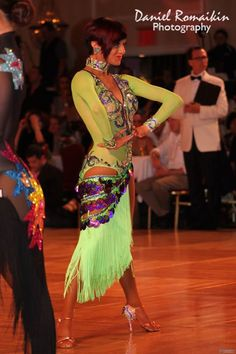 Jean Philippe Milot & Laurence Bolduc | Manhattan Dancesport Championships 2013 [Bright gorgeous green with flattering bodice cut] More photos: http://dancesportinfo.net/Couple/Jean_Philippe_Milot_and_Laurence_Bolduc_35775/Gallery/PeterSuba_3/Competition/Blackpool_Dance_Festival_2013_20341/Professional_Rising_Star_Latin_260548/Photos