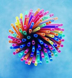 rainbow straws swirling in a glass, backdrop is a sheet of construction paper i painted to resemble clouds  Photograph happy day by Beauty   on 500px