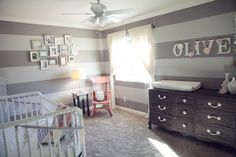 love this nursery + I have a rocking chair just like that waiting to be painted pink :)