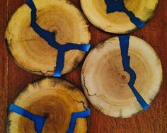 coasters with blue glowing resin inlays Wood coasters with blue glowing resin inlays. Would love to have these for my desk!Wood coasters with blue glowing resin inlays. Would love to have these for my desk! Diy Resin Crafts, Wood Crafts, Kids Crafts, Diy And Crafts, Arts And Crafts, Cardboard Crafts, Art Resin, Wood Resin, Wood And Resin Jewelry