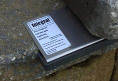 Hidden Hardscape Lighting - Made in the US of non-corrosive materials, hardscape lighting fixtures from Integral Lighting offer a limited lifetime warranty and are super easy to install with a bracket that is held in place by the weight of the hardscape materials. Fixtures are available in 4-, 6-, and 18-inch lengths. The newer LED models are not only energy efficient, but also an especially demure size at only .5-inch high.