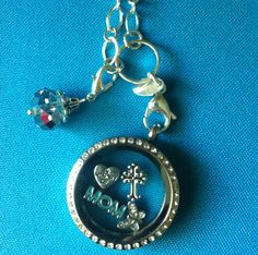 I made this in memory of my mom. To place an order, go to www.jennydemaray.origamiowl.com and add items to shopping bag!