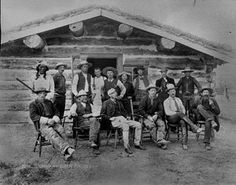Arthur Clarke Huidekoper sits in the middle of the front row (third from left) of this undated photo taken on a ranch in Slope County. The other men are his partners and cowhands, and neighbors. This image is from Set Ranching. North Dakota, Historical Society, Front Row, Ranch, Third, Middle, Building, Men, Image