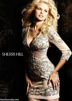 Isn't this Sherri Hill Nude Silver Cocktail Dress 2952 simply gorgeous? Perfect for that summer to fall transition at homecoming. Find this and other great Sherri Hill styles at frenchnovelty.com