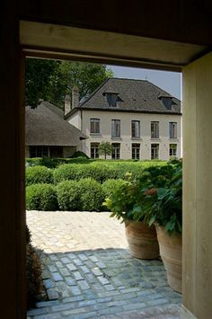 """Garnier Antiques and Interior Architecture, historical residence and showroom """"Vaucelleshof"""". The 10 year renovation by Brigitte and Alain Garnier also includes event hall and catering facilities for rent. Image via the Garnier (be) website as seen on linenandlavender.net"""