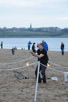 Fire juggler at Littlehaven Promenade opening entertianing crowds on the beach.