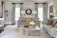 Beautiful neutral room with tan, brown, white and light blue - lovely!