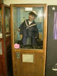 1d in the box and the laughing sailor would spook you out! My Dad loved this but it frightened the life out of me.
