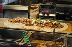 """Iguanas in downtown San Jose is home to the Burritozilla, a 5-lb, 18-in burrito. The challenge is to try finishing it in one sitting! The Burritozilla challenge was featured on the Travel Channel's """"Man V. Food"""" with Adam Richman #SouthBayEats"""