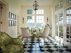 In this elegant country house, a bright, airy bright solarium surrounded by white brick walls and French doors maximizes its natural environment. A pale green settee and moss-green upholstered chairs act as an extension of the trees seen through massive paned windows. Gil Walsh on How Color Can Shape a Room Photos   Architectural Digest