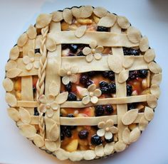 Apple pie with forest berries and caramel sauce.